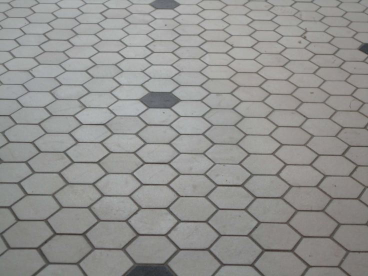 Subway Tile Walls Hex Floor Wood Baseboards And Chair