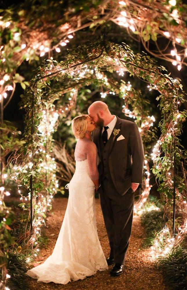 "Say ""I do"" under a glowing archway."