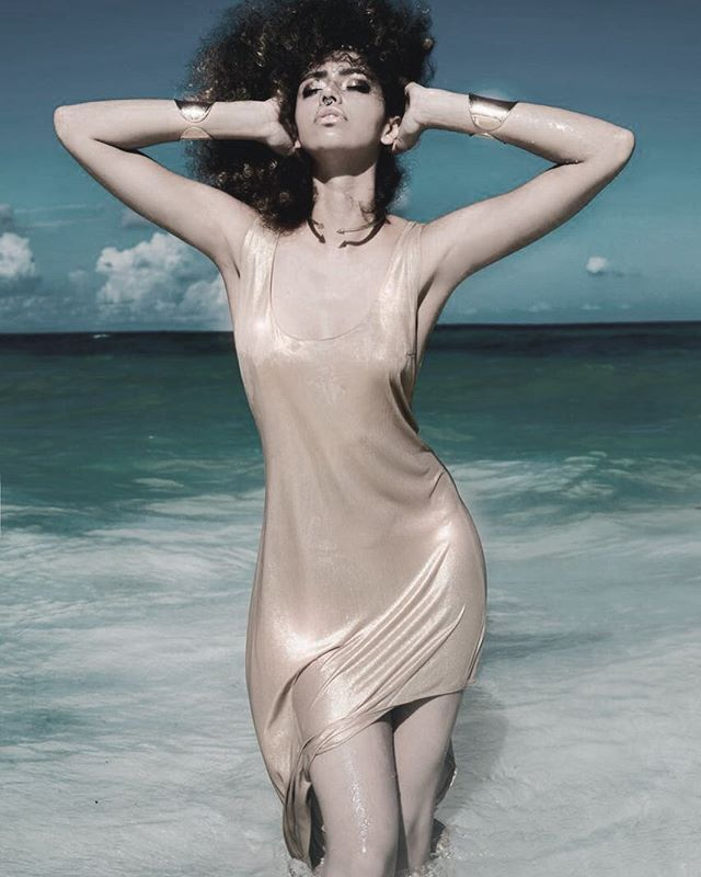 Mermaid Goddess dripping in the CALÓ Sirena Slip Dress Cleo Collar and Brass Cuffs #gold #goddess #madeforwater #dressesyoucanswimin #mermaid #sirena #tulum #resort #sea #mermaidlife #caribbean #CALOtulum End of season sale on now + many other styles! Visit our Tulum store for more details. Address in bio  photo: @portugal_art