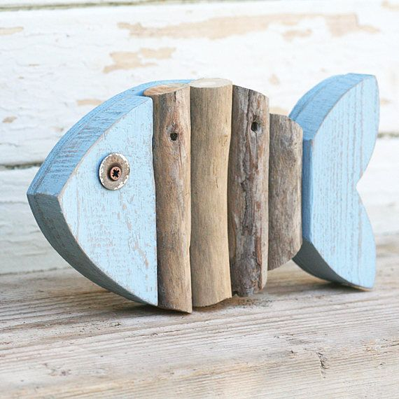 Colorful reclaimed wood fish and natural beached Woods