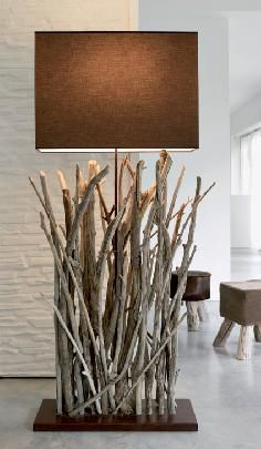 Tall floor lamp with single frame stem with driftwood decoration and metal base