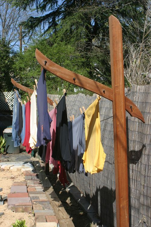 "Clothesline ""Sculpture"" - I can envision putting this at the end of the deck. For evening outdoor gatherings when not in use, put up strings of lights and food/drink table underneath. Or a nice canopy with climbing roses, clematis or other vine flowers....it would smell divine under it!"