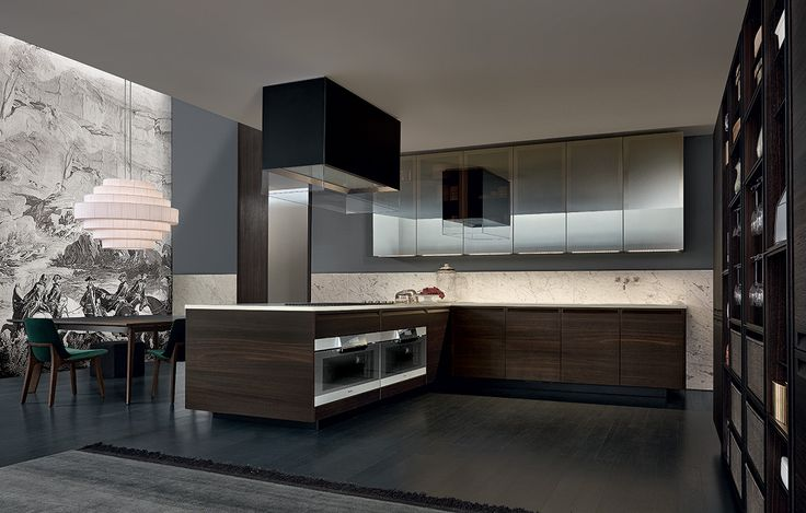Varenna_Minimal kitchen with base units and tall units in spessart oak. Open tall unit in spessart oak with black mat lacquered metal profiles and shelves and wicker baskets.