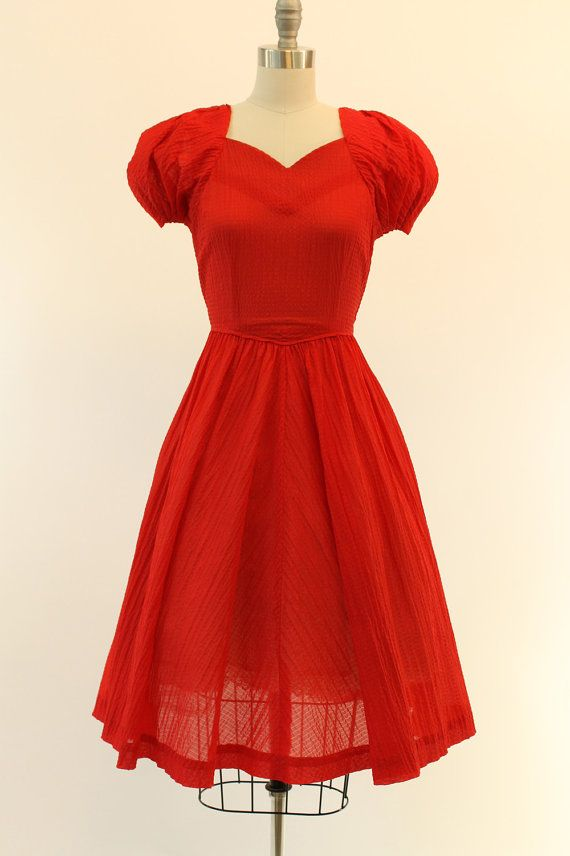 Lipstick red 1940s frock! Done in a sheer puckered organza in a vibrant shade of red. Sweetheart neckline and gathered, ruched sleeves. Slight