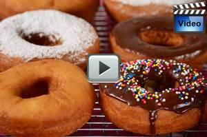 These Cake Doughnuts have a crisp crust yet are soft and cake-like inside. Delicious dipped in a chocolate glaze. From Joyofbaking.com With Demo Video