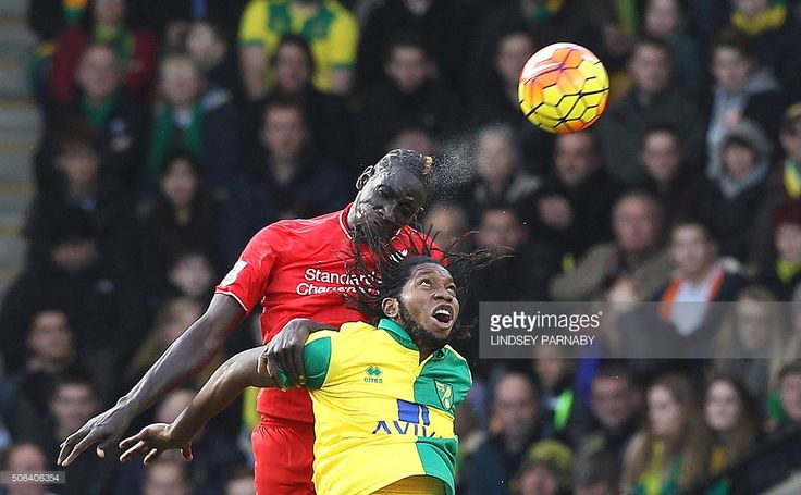 Norwich City's Congolese striker Dieumerci Mbokani vies with Liverpool's French defender Mamadou Sakho (L) during the English Premier League football match between Norwich City and Liverpool at Carrow Road in Norwich, eastern England, on January 23, 2016. AFP PHOTO / LINDSEY PARNABY USE. No use with unauthorized audio, video, data, fixture lists, club/league logos or 'live' services. Online in-match use limited to 75 images, no video emulation. No use in betting, games or single…