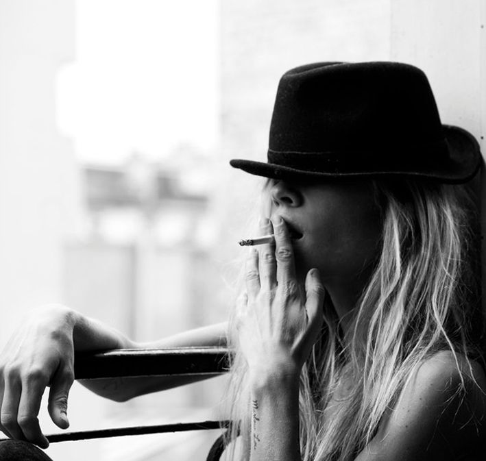 Women who can pull off fedoras.    Hot.    The smoke.    Not so much.    - Angry