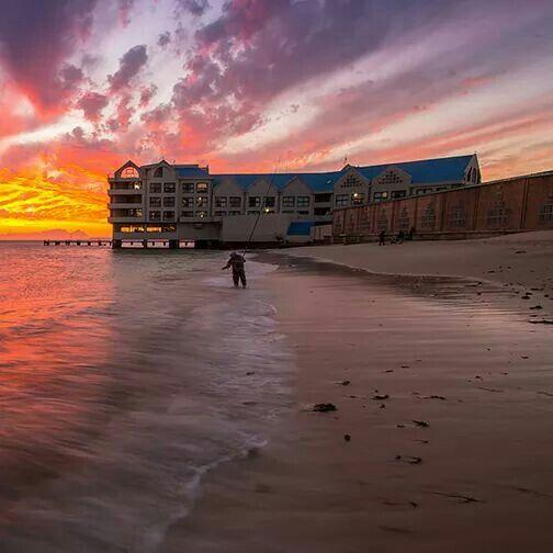 The sun sets on a fisherman on Strand Beach in the Western Cape. via Bryn De Kocks.