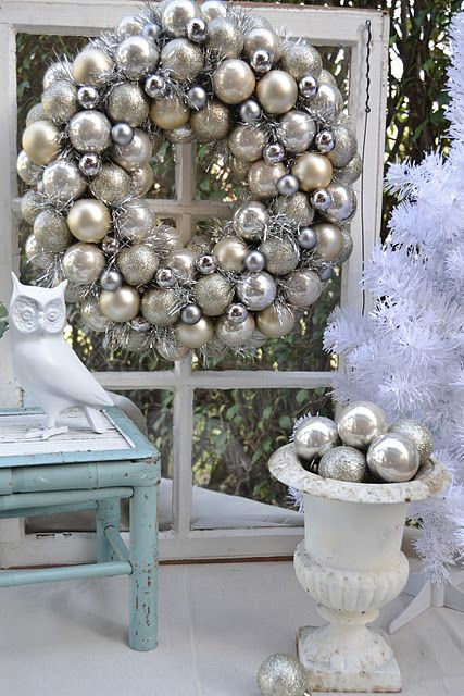Elegant silver vintage looking wreath--Only cost her $7 to make! Oh oh...and I have urns like that on either side of my front door too!
