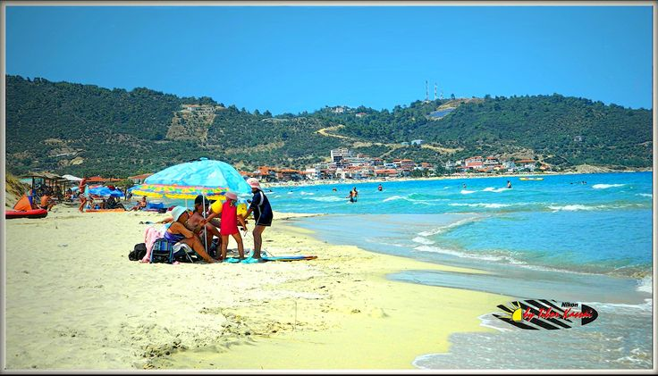""""""" Sarti is a vibrant tourist village with a large sandy beach """""""