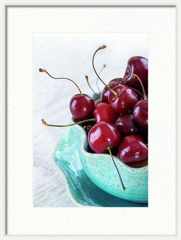 Framed Print featuring the photograph Red Cherries by Oksana Ariskina  Red fruits berries in aqua bowl on white table.  Available as mugs, posters, greeting cards, phone cases, throw pillows, framed fine art prints, metal, acrylic or canvas prints, shower curtains, duvet covers with my fine art photography online: www.oksana-ariskina.pixels.com #OksanaAriskina