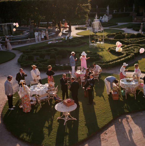 Title:Garden Party   Caption:1970: An elegant garden party in Miami, Florida.       Artist:Slim Aarons  Date:1970