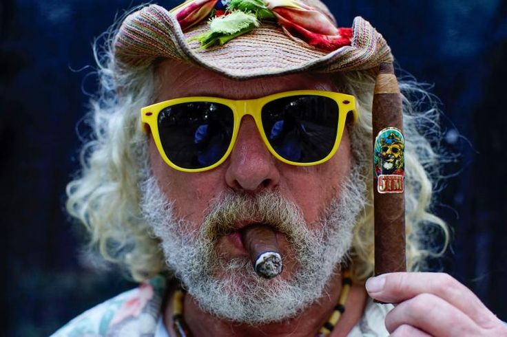 Holding a cigar - Ardan News