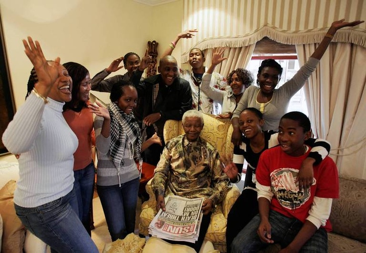 Former South African President Nelson Mandela celebrates his 86th birthday with his wife Graca Machel, left, and ex-wife Winnie Madikizela Mandela, right, in his rural home town of Qunu, South Africa. — Getty Images, July 18, 2004