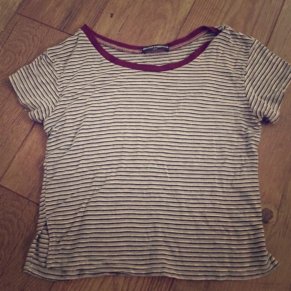 Brandy Melville striped loose crop top Striped black white and grey with red trim brandy top. Gently used. Brandy Melville Tops Crop Tops