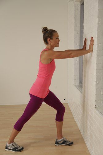 Make the most of a wall to give your calves a nice deep stretch.  Stand a little less than arm's distance from the wall.  Step your left leg forward and your right leg back, keeping your feet parallel. Bend your left knee and press through your right heel.  Hold for 20 to 30 seconds and switch legs.                   Source: POPSUGAR Studios