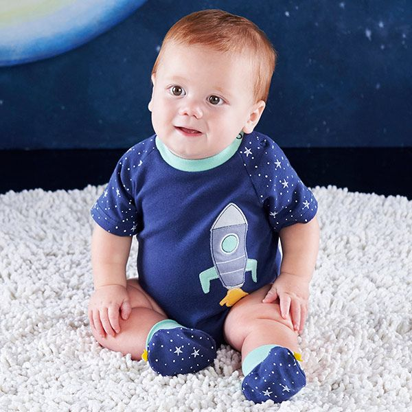 Baby Aspen's Cosmo Tot Spaceship 2-Piece Layette Set features a space-themed blue bodysuit and matching booties to keep baby's feet warm throughout the night.