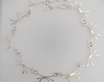I think the links on this chain look like crabs. There are other necklaces on the website