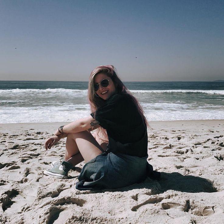 Look turista na praia.