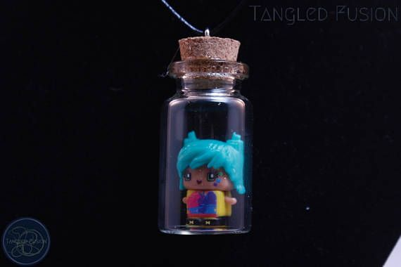 Quirky Glass Vial Necklace with MixieQ Figurine on Leather https://www.etsy.com/au/listing/533294683/quirky-glass-vial-necklace-with-mixieq?ref=shop_home_active_8