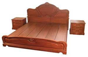 Modern platform bed with hand carving.