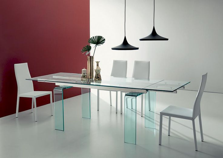 PHANTOM. Glass becomes form, surface, function. Phantom represents space and light. Extending dining table with curved transparent glass legs, glass top and visible extensions under the top, running metal mechanism. http://www.easy-line.it