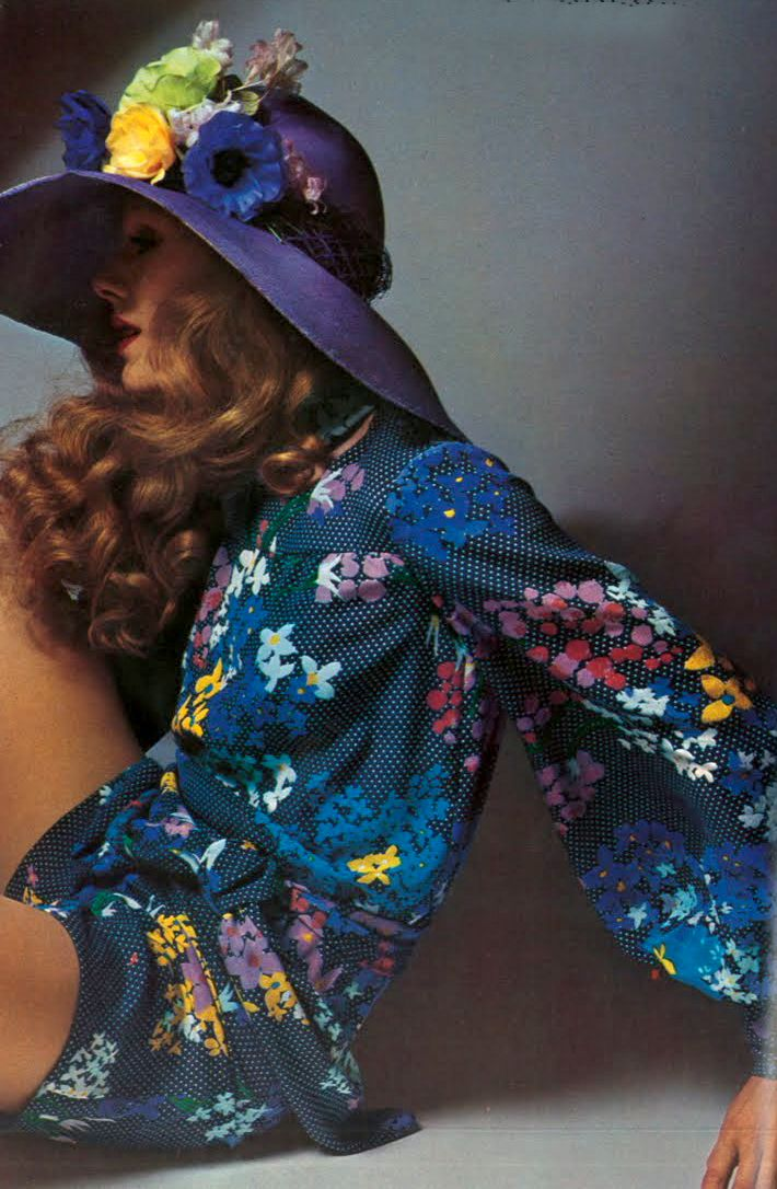 Photo by Guy Bourdin, 1971.  The Teen Shop had all the floppy brimmed hats with flowers.  I ended up getting a straw boater with flowers on it.  It was way too big for me (all hats are) but I J'adored it soooo much that I bought it anyway.  The only picture of it now is on my Dad's head sunlounging in the back yard...bless his little rotten socks!