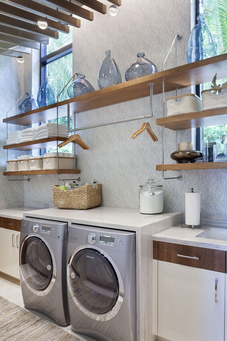 7 Laundry Room Design Ideas To Incorporate Into Your Own Laundry // A hanging bar for drip drying clothes