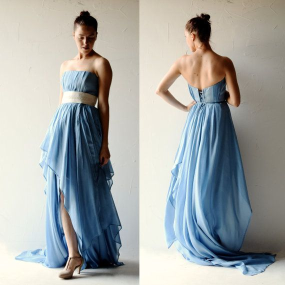 This stately, elegant gown is both romantic and effortless, flowing lightly around your body, following every breath of air.  The flowing skirt is