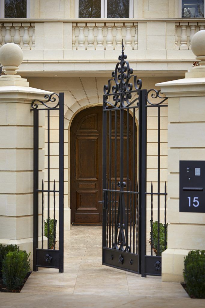 Wrought Iron Gate And Feature Limestone Facade Of