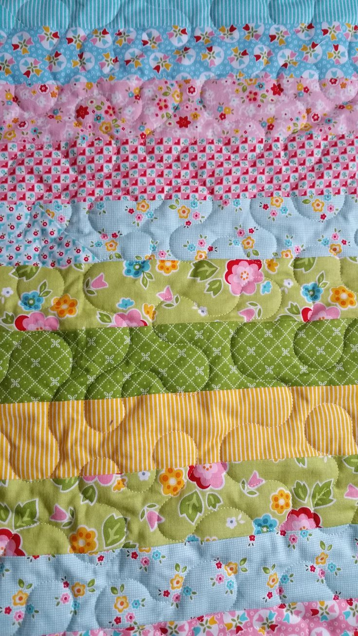 Quilting done on my Jelly Roll Race Quilt, that my mother made for me.