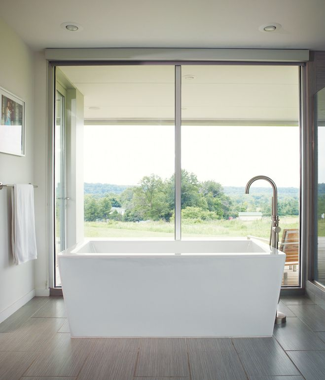 The best view in the house may be from the freestanding Eaton acrylic bathtub off the master bedroom, which overlooks a neighboring pasture. photos by: Joe Pugliese