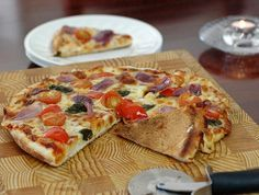One Pan Pizza:  my oven quit working tonight...I found this stove top pizza recipe and it worked!   oh, and I just used all whole wheat flour.