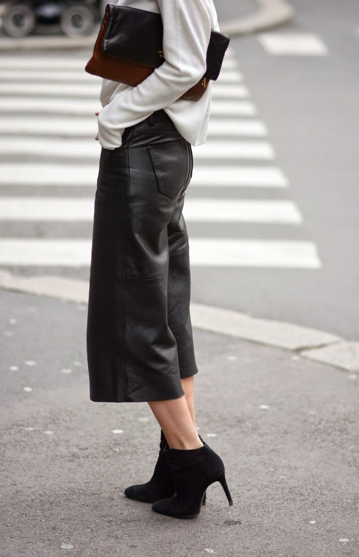"afashionlines: ""slfmag: "" Street style fashion: two-tone clutch + white top + black leather crop pants + booties. "" http://afashionlines.tumblr.com/ "" www.fashionclue.net 