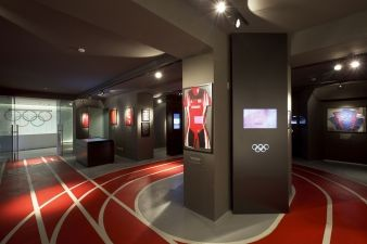 Athletic track markings on the floor guide visitors around the museum-like reception area