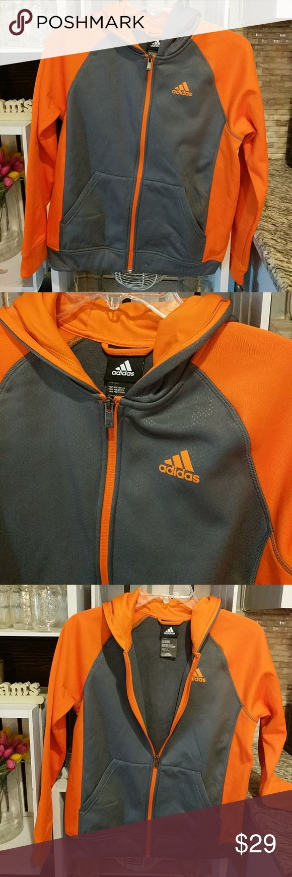 Nike zip up hoody. New with tags Gray and orange zip up with hood. Very soft. Fits woman's small Adidas Jackets & Coats