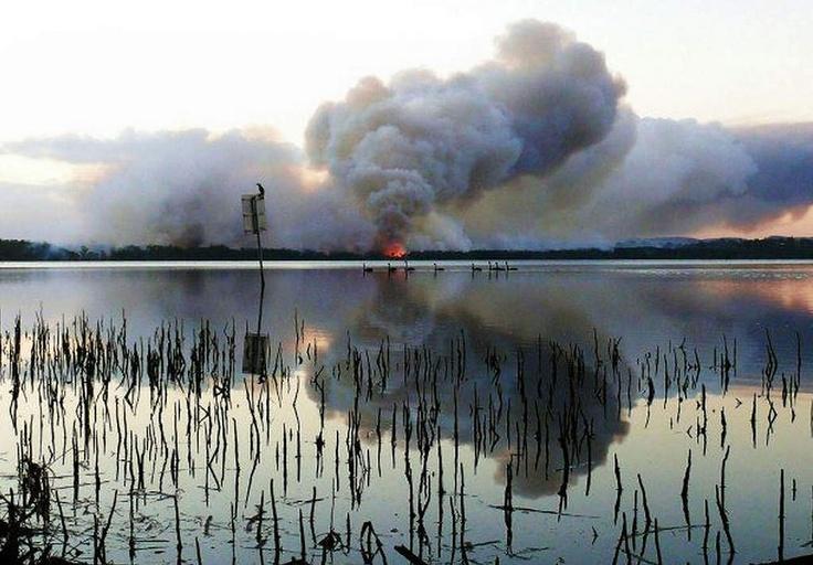 Smoke billowing as a bushfire burns near Green Point in New South Wales.