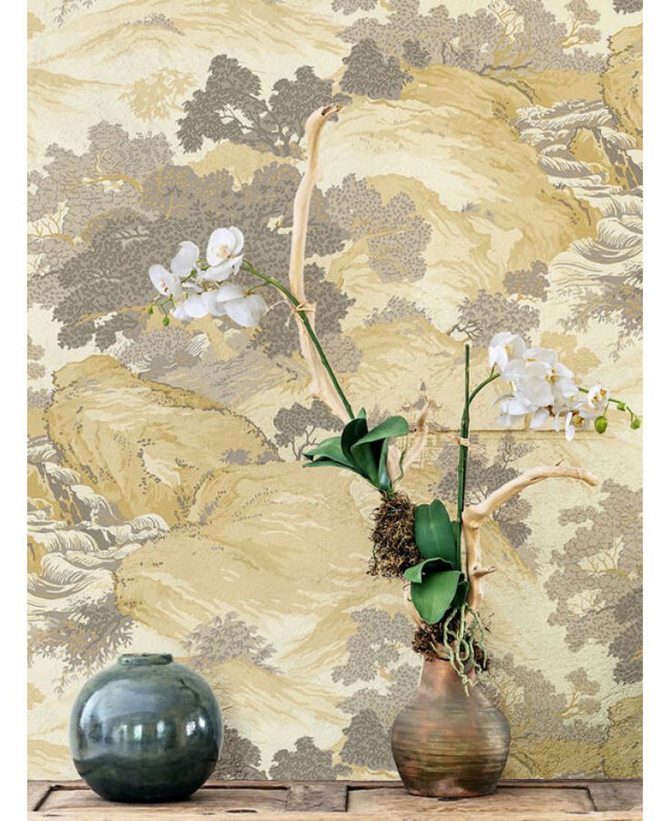 The Crown Archives Oriental Landscape Wallpaper in yellow, taupe and cream is a modern take on a classic wallpaper with subtle metallic highlights. Free UK delivery available