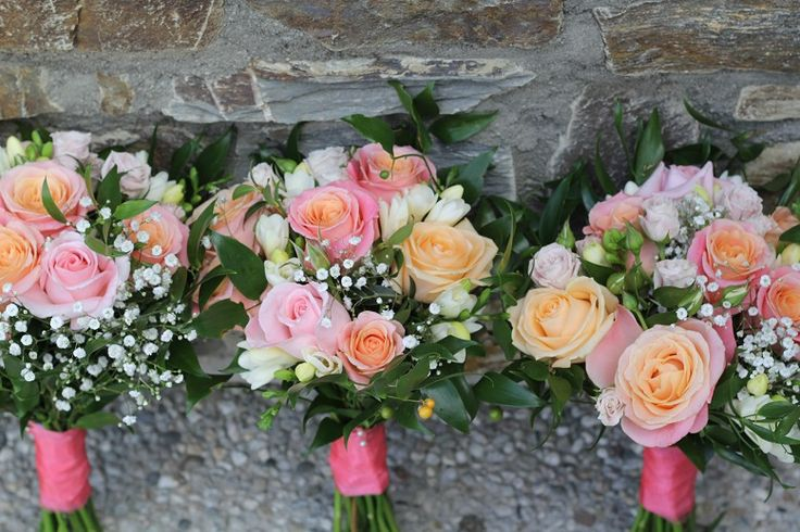 Coral bouquets with baby's breath http://www.wanakaweddingflowers.co.nz/gallery/