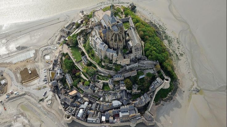 An aerial view taken on May 5, 2014 shows the Mont St Michel, northwestern France. The Benedictine Abbey stands on a rocky island in the center of a bay invaded by the largest tides in Europe. (JEAN-SEBASTIEN EVRARD/AFP/Getty Images)