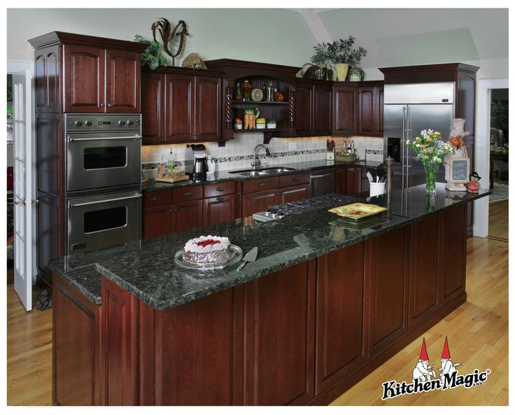 Cordovan Cherry Wood Cabinets. --Kitchen Magic, Inc.--