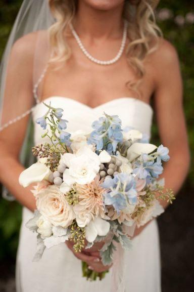 Can't get enough of this light blue and peach bouquet! // photo by http://www.stephanieasmith.com, via http://theeverylastdetail.com/beach-chic-light-blue-peach-wedding/ #wedding #bouquet #flowers