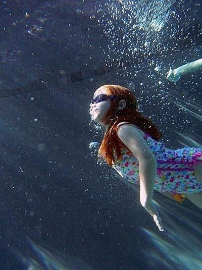 my friend Lisa's underwater photo of her daughter.  Coolest lighting ever.