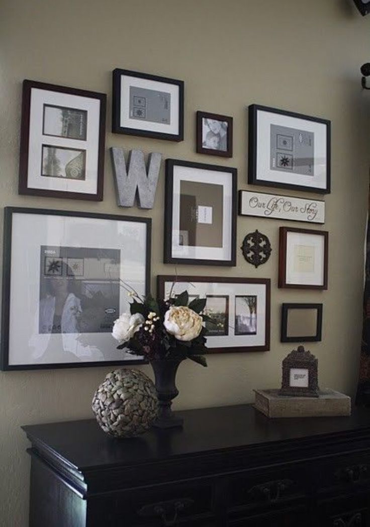 A photo wall for the living room or foyer/entry hall - love this decor idea!