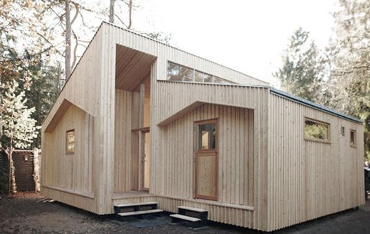 This sustainable home was built on the cheap using digital design, and is located in woods north of Copenhagen. It comprises 1,345 square feet, and was constructed using 820 sheets of plywood cut via a CNC printer — which is, essentially a room-sized, computerized drill. The home went up in just four weeks.