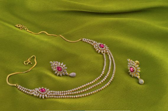 Three layer diamonds with small aside pendants off set with rubies