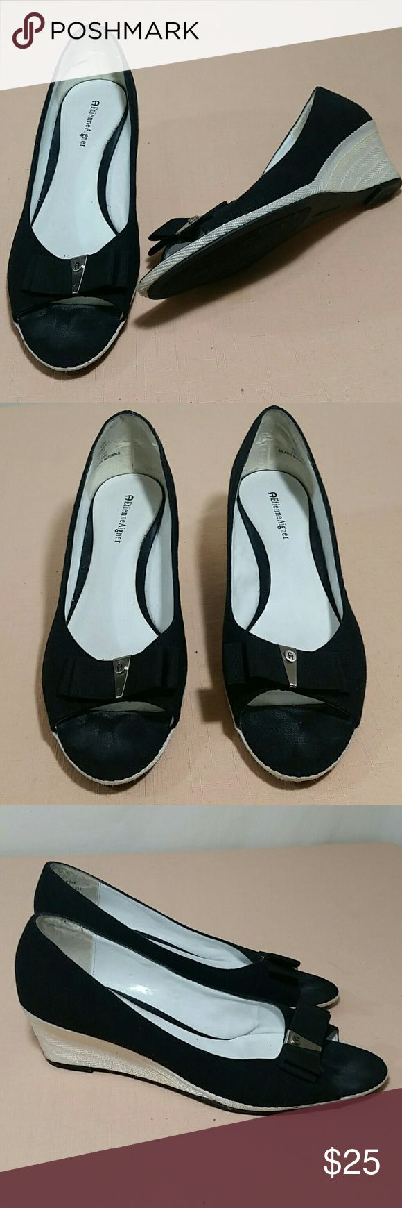 """ETIENNE AIGNER Peep Toe Wedges Size 9 1/2 Beautiful ETIENNE AIGNER black peep toe Wedges.   This pair of Wedges has a 2 1/4"""" heel.  This pair of shoes are a size 9 1/2.  This pair of ETIENNE AIGNER Wedges are in excellent condition. Etienne Aigner Shoes Wedges"""