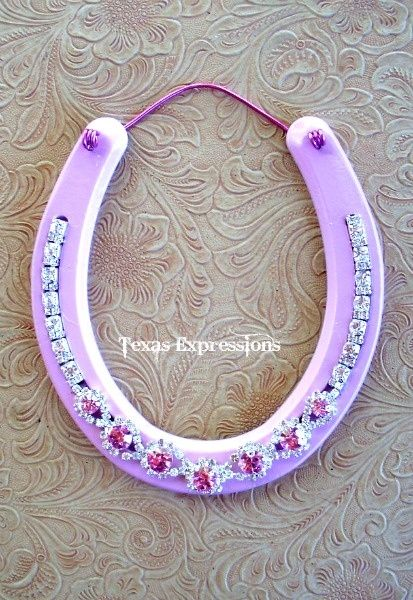 pink horseshoe, summer project for girls room. One in purple cheetah for cady and one in pink sparkle for leila