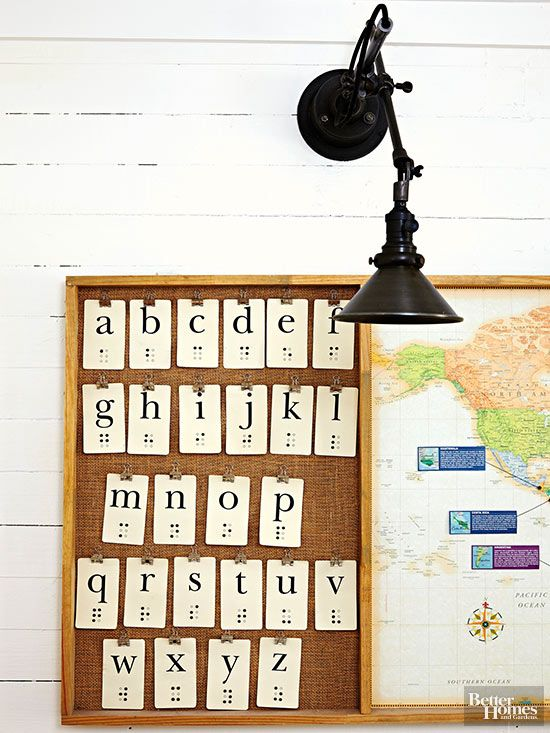 To assist with home education, the couple created an inexpensive wall fixture out of hardboard with three smart sections, including a map and chalkboard. On the final panel, binder clips hold alphabet cards against a burlap backdrop. A homemade stain created by steeping steel wool in cider vinegar gives its basic pine frame an aged appearance.