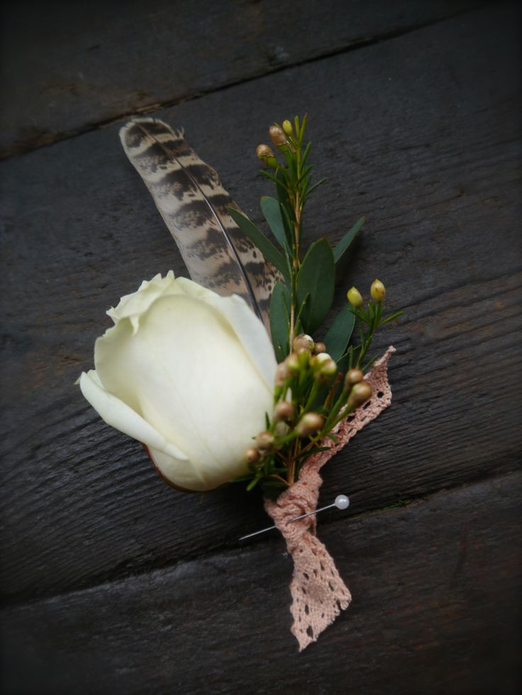 """White rose buttonhole with a feather touch from Pink Peony. For more Alternative Wedding inspiration, check out the No Ordinary Wedding article """"20 Quirky Alternatives to the Traditional Wedding""""  http://www.noordinarywedding.com/inspiration/20-quirky-alternatives-traditional-wedding-part-2"""